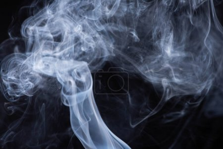 Photo for White flowing smoke cloud on black background - Royalty Free Image