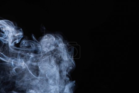 Photo for White flowing smoke cloud on black background with copy space - Royalty Free Image