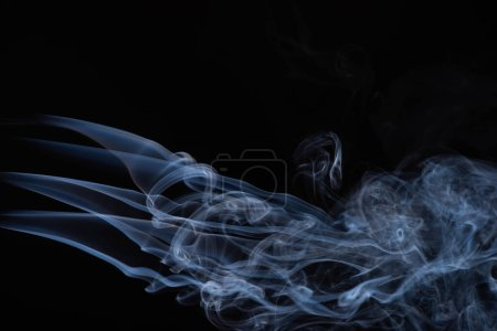 white flowing smoke cloud on black background with copy space