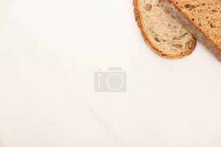 Photo for Top view of fresh whole grain bread slices on white background - Royalty Free Image
