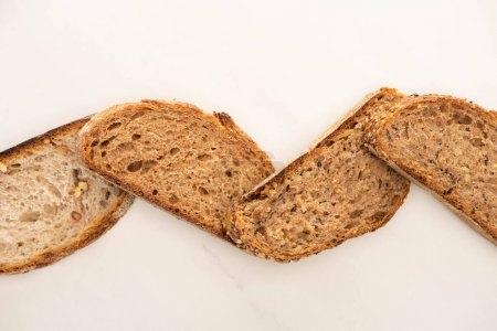 Photo for Top view of whole grain bread slices on white background - Royalty Free Image