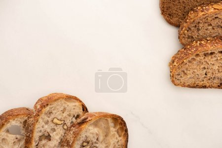 Photo for Top view of fresh whole wheat bread slices on white background with copy space - Royalty Free Image