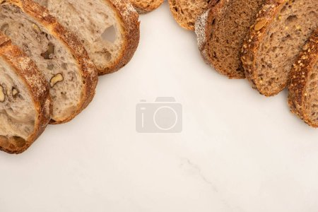 Photo for Top view of whole wheat bread slices on white background with copy space - Royalty Free Image