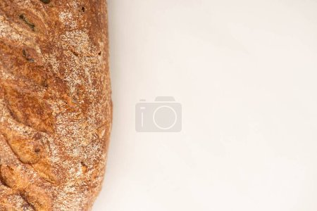 Photo for Top view of fresh whole wheat bread loaf on white background with copy space - Royalty Free Image