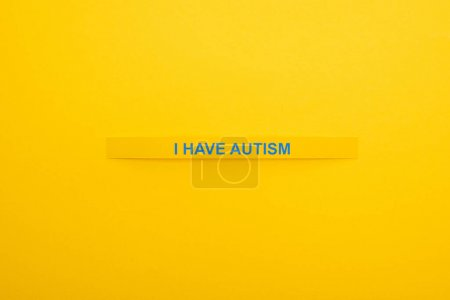 top view of bracelet with I have autism inscription isolated on yellow