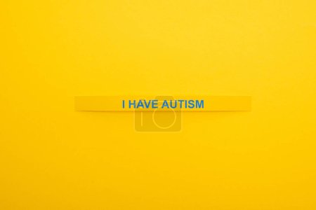 Photo for Top view of bracelet with I have autism inscription isolated on yellow - Royalty Free Image
