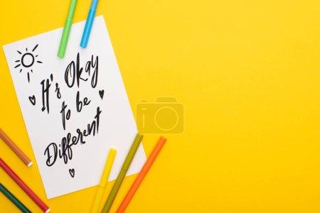 Foto de Vista superior de los bolígrafos de fieltro en la hoja de papel con su autorización para ser diferente inscripción aislada en amarillo - Imagen libre de derechos