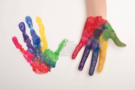 Photo for Cropped view of female hand with colorful handprint on white for World Autism Awareness Day - Royalty Free Image