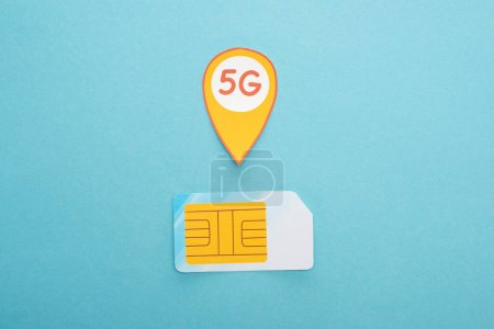 top view of sim card and 5g lettering on blue background