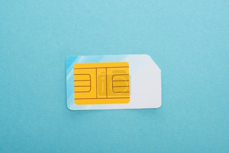 top view of sim card on blue background
