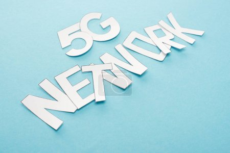 Photo for White 5g network lettering on blue background - Royalty Free Image