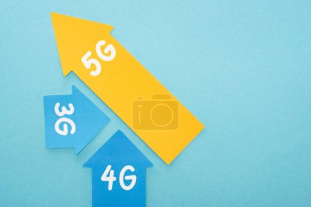 Photo for Top view of 3g, 4g and 5g arrows on blue background - Royalty Free Image