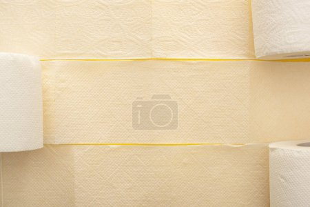 Photo for Top view of unrolled white toilet paper on yellow background - Royalty Free Image