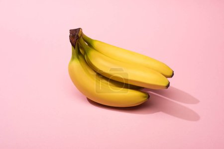 Photo for Ripe yellow bananas on pink background - Royalty Free Image