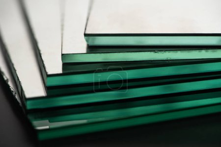 Photo for Close up view of mirror pieces in stack on dark background - Royalty Free Image