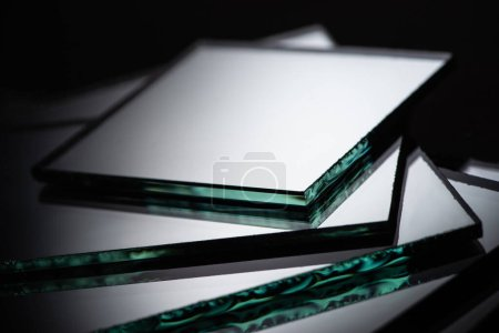 Photo for Close up view of mirror pieces in stack on black background - Royalty Free Image