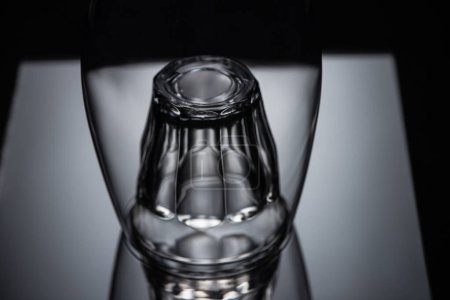 Photo for Close up view of shot glass in wine glass in dark - Royalty Free Image