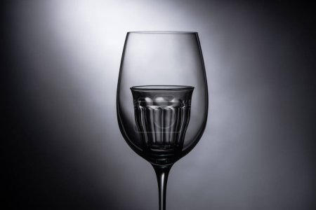 Photo for Empty shot glass in wine glass on dark background - Royalty Free Image