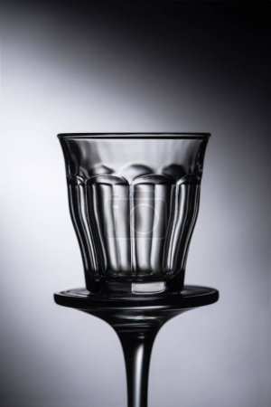 Photo for Close up view of empty shot glass on dark background - Royalty Free Image