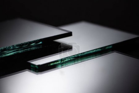 Photo for Close up view of square mirror pieces in stack on black - Royalty Free Image