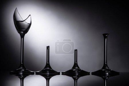 Photo for Broken sharp transparent glasses in dark - Royalty Free Image