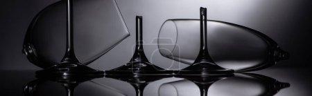 Photo for Broken sharp transparent glasses in dark, panoramic shot - Royalty Free Image