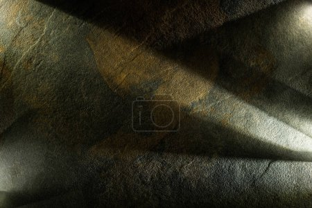 light prism with beams on dark stone texture background