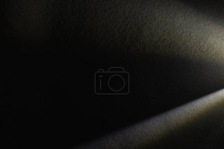 light prism with beams on dark textured background