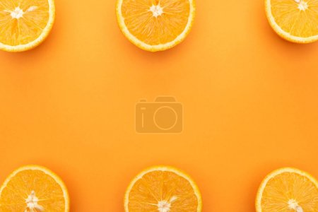 Photo for Top view of juicy orange slices on colorful background - Royalty Free Image