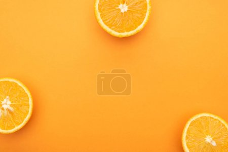 top view of juicy orange slices on colorful background