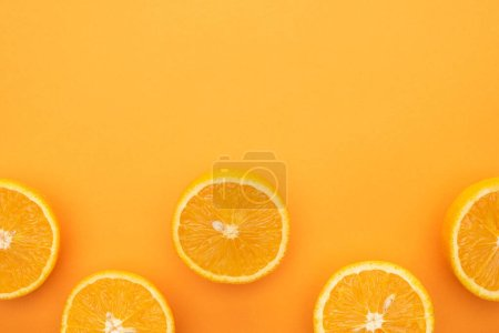 Photo for Top view of ripe juicy orange slices on colorful background with copy space - Royalty Free Image