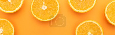 Photo for Top view of ripe juicy orange slices on colorful background, panoramic crop - Royalty Free Image