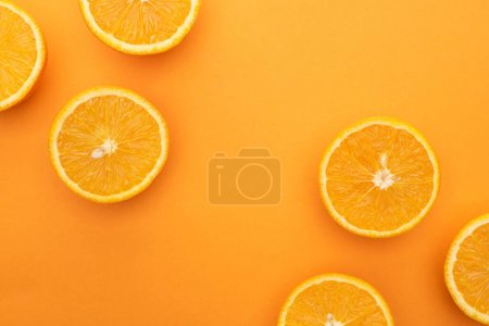 Photo for Top view of ripe juicy orange slices on colorful background - Royalty Free Image