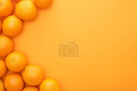 Photo for Top view of ripe juicy whole oranges on colorful background with copy space - Royalty Free Image