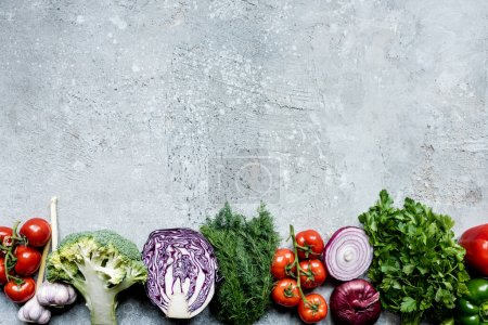 Photo for Top view of fresh ripe vegetables on grey concrete surface with copy space - Royalty Free Image