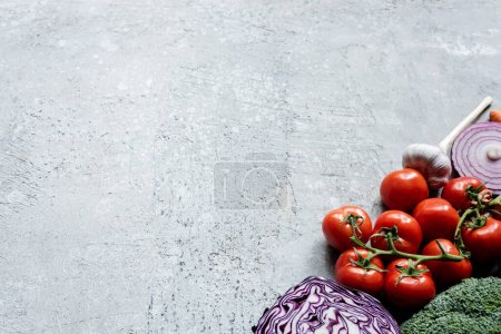 Photo for Colorful fresh ripe vegetables on grey concrete surface - Royalty Free Image