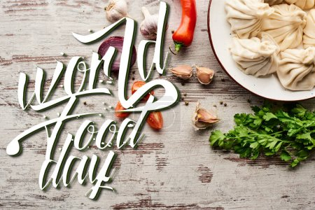 Photo for Top view of delicious khinkali near vegetables and spices on wooden table with copy space, world food day illustration - Royalty Free Image