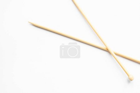 Photo for Beige knitting needles on white background with copy space - Royalty Free Image