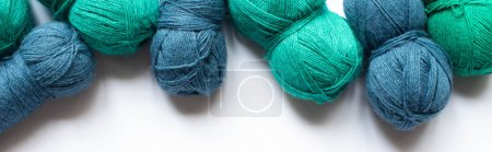 Photo for Top view of blue and green wool yarn on white background, panoramic orientation - Royalty Free Image