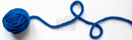 Photo for Top view of blue wool yarn on white background, panoramic orientation - Royalty Free Image