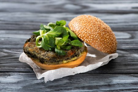 Photo for Tasty vegan burger with microgreens served on wooden table - Royalty Free Image