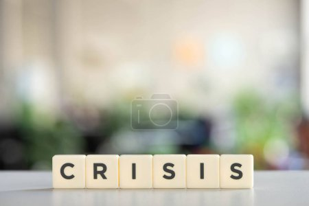 white cubes with world crisis on white desk in office