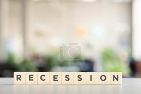 white blocks with recession word on office desk