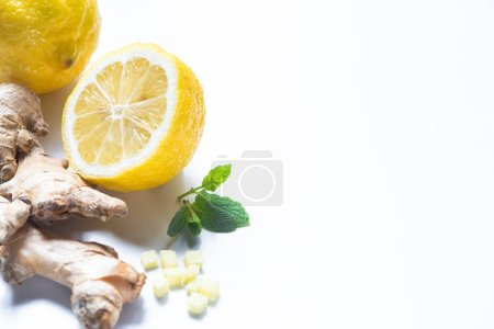 Photo for Fresh ginger root, lemon and mint on white background - Royalty Free Image