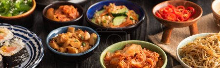 Photo for Horizontal crop of tasty korean dishes on wooden surface - Royalty Free Image