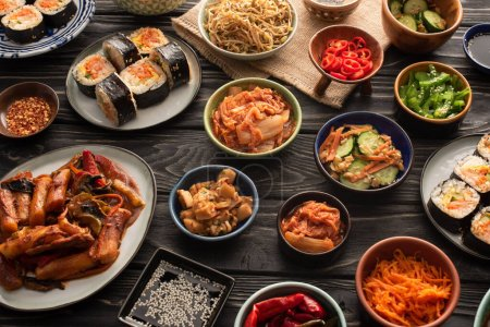 Photo for Selective focus of traditional and tasty korean dishes on wooden surface - Royalty Free Image