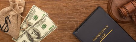 Photo for Top view of money, bankruptcy law book and gavel on wooden background, panoramic shot - Royalty Free Image