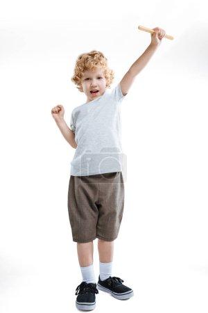 little kid boy holding stick