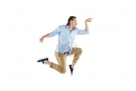 Young man jumping and looking away