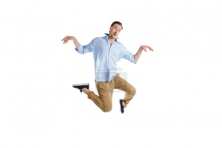 Young man jumping with facial expression